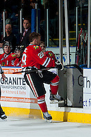 KELOWNA, CANADA - APRIL 25: Brendan Leipsic #28 of the Portland Winterhawks exits the ice after a late game penalty against the Kelowna Rockets on April 25, 2014 during Game 5 of the third round of WHL Playoffs at Prospera Place in Kelowna, British Columbia, Canada. The Portland Winterhawks won 7 - 3 and took the Western Conference Championship for the fourth year in a row earning them a place in the WHL final.  (Photo by Marissa Baecker/Getty Images)  *** Local Caption *** Brendan Leipsic;