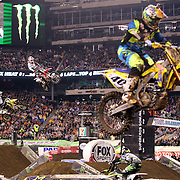 James Stewart, (left), Suzuki and Trey Canard, Honda, in action during the 450SX Class Championship during round 16 of the Monster Energy AMA Supercross series held at MetLife Stadium. 62,217 fans attended the event held for the first time at MetLife Stadium, New Jersey, USA. 26th April 2014. Photo Tim Clayton