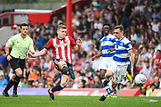 Brentford Midfielder Lewis Macleod (4) in action during the EFL Sky Bet Championship match between Brentford and Queens Park Rangers at Griffin Park, London, England on 21 April 2018. Picture by Stephen Wright.