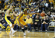 26 JANUARY 2009: Iowa guard Kachine Alexander (21) lets the ball get away from her while being defended by Michigan guard/forward Carmen Reynolds (33) during the first half of an NCAA women's college basketball game Monday, Jan. 26, 2009, at Carver-Hawkeye Arena in Iowa City, Iowa. Iowa defeated Michigan 77-69.