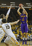 December 07 2010: Northern Iowa Panthers forward Chip Rank (4) pulls up for a shot during the first half of their NCAA basketball game at Carver-Hawkeye Arena in Iowa City, Iowa on December 7, 2010. Iowa defeated Northern Iowa 51-39.
