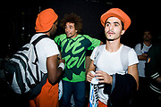 Two dancers with organge hat. One of them talking to man in green T-shirt. UK B-Boy championships 06. 08/10/2006