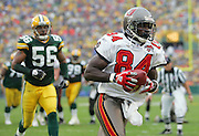 GREEN BAY, WI - SEPTEMBER 25:  Wide receiver Joey Galloway #84 of the Tampa Bay Buccaneers catches a ten yard touchdown pass in the second quarter for a 14-6 lead over the Green Bay Packers at Lambeau Field on September 25, 2005 in Green Bay, Wisconsin. The Buccaneers defeated the Packers 17-16. ©Paul Anthony Spinelli *** Local Caption *** Joey Galloway