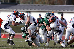 10 November 2007: Nick Nikolich wraps up Brett Jackson. This game between the Wheaton College Thunder and the Illinois Wesleyan University Titans was for a share of the CCIW Championship and was played at Wilder Field on the campus of Illinois Wesleyan University in Bloomington Illinois.