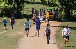 © Licensed to London News Pictures. 30/05/2020. London, UK. Members of the public go out in the sunshine in Richmond Park, South West London as weather experts predict another warm weekend with highs of 28c. On Monday, up to six people will be allowed to meet up in parks and private gardens. Photo credit: Alex Lentati/LNP