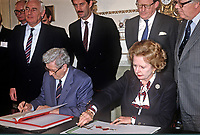 Signing of Anglo-Irish Agreement by Margaret Thatcher, Prime Minister, UK, and Garret Fitzgerald, Prime Minister, An Taoiseach, Rep of Ireland, at Hillsborough Castle, N Ireland, 15th November 1985. Also in the photo are (from left): Peter Barry, Irish Foreign Minister, Dick Spring, Deputy Prime Minister, Tom King, Secretary of State for N Ireland, and Geoffrey Howe, UK Foreign Secretary. 1985111505m.<br /> <br /> Copyright Image from Victor Patterson, Belfast, UK, BT9 5HG<br /> <br /> t: +44 28 9066 1296 (from Rep of Ireland 048 9066 1296)<br /> m: +44 7802 353836<br /> <br /> victorpattersonbelfast@gmail.com<br /> www.victorpatterson.com<br /> <br /> Please see my Terms and Conditions of Use at https://www.victorpatterson.com/page2<br /> It is IMPORTANT that you familiarise yourself with them.<br /> <br /> Images used on the Internet incur an additional cost and must be visibly watermarked i.e. © Victor Patterson within the body of the image and copyright metadata must not be deleted. Images used on the Internet have a size restriction of 4kbs and are chargeable at rates available at victorpatterson.com.<br /> <br /> This image is only available for the use of the download recipient i.e. television station, newspaper, magazine, book publisher, etc, and must not be passed on to any third party. It is also downloaded on condition that each and every usage is notified within 7 days to victorpattersonbelfast@gmail.com.<br /> <br /> The right of Victor Patterson to be identified as the author is asserted in accordance with The Copyright Designs And Patents Act (1988). All moral rights are asserted.