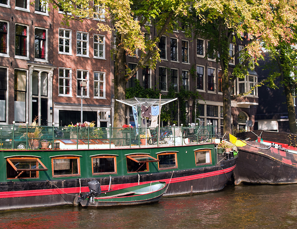 Amsterdam canal scene. Houseboat living, on an Amsterdam canal.