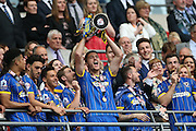 AFC Wimbledon defender Ryan Sweeney (20) lifting the trophy during the Sky Bet League 2 play off final match between AFC Wimbledon and Plymouth Argyle at Wembley Stadium, London, England on 30 May 2016.