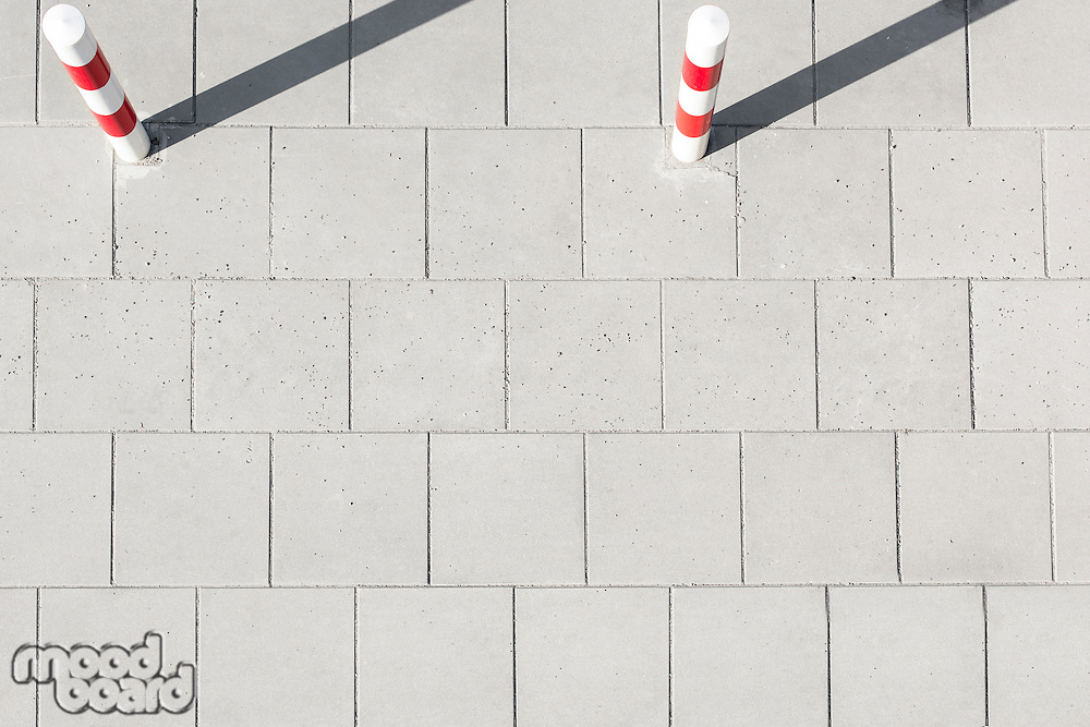 High angle view of striped poles on sidewalk