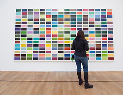 Woman looking at painting 256 Farben by Gerhard Richter at Bonn Kunstmuseum or Art Museum in Germany