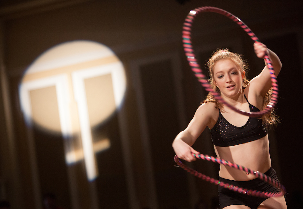 Hannah Stanton-Gockel performs with hula hoops at the Sixth Annual International Women's Day Festival, held in Baker Center Ballroom on March 16, 2014. The event, organized by the Ohio University Women's Center, included numerous performances and vendors that emphasized women's education and advocacy. International Women's Day itself fell on March 8, 2014. Photo by Lauren Pond