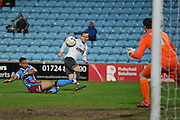 Chris Hussey (3) of Bury kicks towards goal but deflected by Jordan Clarke of Scunthorpe United  during the Sky Bet League 1 match between Scunthorpe United and Bury at Glanford Park, Scunthorpe, England on 19 April 2016. Photo by Ian Lyall.
