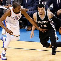 08 May 2016: San Antonio Spurs guard Danny Green (14) drives past Oklahoma City Thunder forward Kevin Durant (35) during the Oklahoma City Thunder 111-97 victory over the San Antonio Spurs, during Game Four of the Western Conference Semifinals of the NBA Playoffs at the Chesapeake Energy Arena, Oklahoma City, Oklahoma, USA.