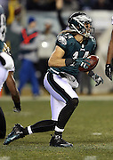 Philadelphia Eagles wide receiver Riley Cooper (14) gets up after catching a first down pass during the NFL NFC Wild Card football game against the New Orleans Saints on Saturday, Jan. 4, 2014 in Philadelphia. The Saints won the game 26-24. ©Paul Anthony Spinelli
