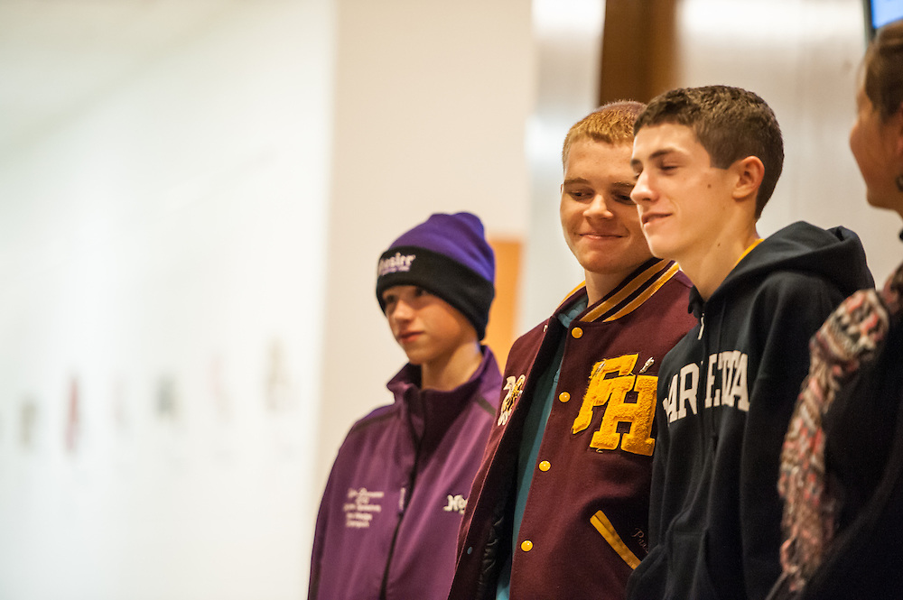 Skylar Zimmerman, 15, Shawn Parsons, 17, and Zach Engle, 17, are among a few of the students who have art displayed at the 6th Annual Art Extravaganza in the McCracken Hall Gallery on Monday, November 5, 2012. The auction will provide money necessary to buy a kiln for the class.