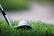 a close up of a pitching wedge at address to the ball in the rough viwed from down the line<br /> Photo Mark Newcombe