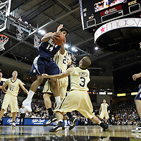Arsalan Kazemi (14) of Iran, and Central Florida guard A.J. Rompza (3) reach for a rebound during a Conference USA NCAA basketball game between the Rice Owls and the Central Florida Knights at the UCF Arena on January 22, 2011 in Orlando, Florida. Rice won the game 57-50 and extended the Knights losing streak to 4 games.  (AP Photo/Alex Menendez)