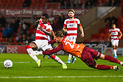 Doncaster Rovers forward Niall Ennis (31) and Blackpool goalkeeper Jak Alnwick (23) in action during the EFL Sky Bet League 1 match between Doncaster Rovers and Blackpool at the Keepmoat Stadium, Doncaster, England on 17 September 2019.