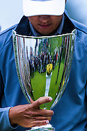 James Hahn, holds the winner's trophy after winning the PGA Tour Northern Trust Open golf tournament on the third playoff hole at Riviera Country Club, Sunday, February 22, 2015, in Los Angeles.