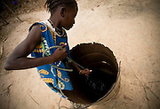 A girl pulls water from a well in the village of Essaout, Senegal, on Thursday June 14, 2007.