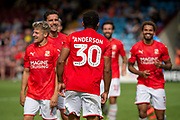 Keshi Anderson of Swindon Town celebrates as he makes it 0-2 during the EFL Sky Bet League 2 match between Scunthorpe United and Swindon Town at Sands Venue Stadium, Glanford Park, Scunthorpe, England on 3 August 2019.