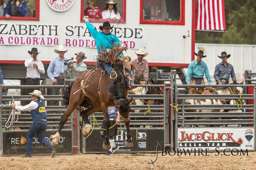 Saddle brond rider Josh Davison rides Summit Pro Rodeo's Big Hole during the third performance of the Elizabeth Stampede on Sunday, June 3, 2018.