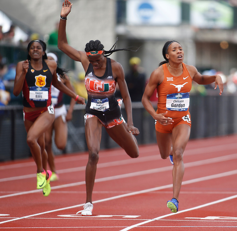 Texas' Chrisann Gordon, right, crosses the finish line ahead of Miami's Shakima Wimbley, center, and USC's Kendall Ellis, left, to win the women's 400 meters in the time of 50.51 seconds on the final day of the NCAA outdoor college track and field championships in Eugene, Ore., Saturday, June 10, 2017. (AP Photo/Timothy J. Gonzalez)