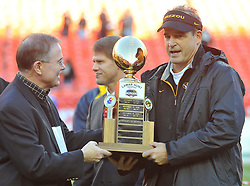 Nov 27, 2010; Kansas City, MO, USA; Brady Deeton, Chancellor at Missouri (left) presents the Lamar Hunt trophy to Missouri Tigers head coach Gary Pinkel after the Tigers defeated the Kansas Jayhawks 35-7 at Arrowhead Stadium. Mandatory Credit: Denny Medley-US PRESSWIRE
