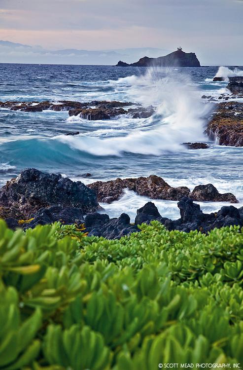 Crashing waves in Waianapanapa, view of Alau island, Hana, Maui, Hawaii