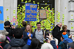 Put it to the People demonstration in central London against Brexit and an appeal for a Peoples Vote on a final Deal. Stickers all over The Cabinet Office front door. London UK 23 March 2019
