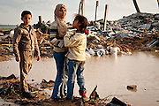 Children stand amid the wreckage of homes in Jabaliya.