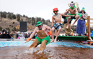 NEDERLAND, CO - MARCH 10: A group jumps into icy brown water in the Frozen Dead Guy Days Polar Plunge competition at the event on March 10, 2018 in Nederland, Colorado. The Frozen Dead Guy Days festival is in honor of Bredo Morstol, who is frozen on dry ice and housed in a shed above the town. (Photo by Rick T. Wilking/Getty Images)