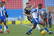 Ian Henderson and Donervan Daniels during the EFL Sky Bet League 1 match between Wigan Athletic and Rochdale at the DW Stadium, Wigan, England on 24 February 2018. Picture by Daniel Youngs.