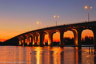 Night view of Merrill P. Barber Bridge a concret arch bridge spanning the Indian River intercoastal waterway in Indian River County, Florida