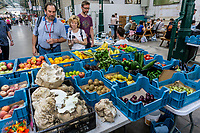 Vegetable stall, St George's Market, Belfast, N Ireland, UK, August, 2019, 201908241299<br /><br />Copyright Image from Victor Patterson, Belfast, UK<br /><br />t: +44 28 9066 1296 (from Rep of Ireland 048 9066 1296)<br />m: +44 7802 353836<br /><br />victorpattersonbelfast@gmail.com<br />www.victorpatterson.com<br /><br />Please see my Terms and Conditions of Use at https://www.victorpatterson.com/page2<br />It is IMPORTANT that you familiarise yourself with them.<br /><br />Images used online incur an additional cost and must be visibly watermarked i.e. © Victor Patterson within the body of the image and copyright metadata must not be deleted. Images used on the Internet have a size restriction of 4kbs and are chargeable at rates available at victorpatterson.com.<br /><br />This image is only available for the use of the download recipient i.e. television station, newspaper, magazine, book publisher, etc, and must not be passed on to any third party. It is also downloaded on condition that each and every subsequent usage is notified within 7 days to victorpattersonbelfast@gmail.com<br /><br />The right of Victor Patterson to be identified as the author is asserted in accordance with The Copyright Designs And Patents Act (1988). All moral rights are asserted.