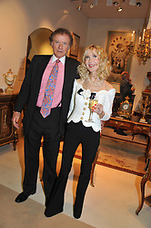 RICHARD & BASIA BRIGGS at a preview evening of the annual London LAPADA (The Association of Art & Antiques Dealers) antiques Fair held in Berkeley Square, London on 18th September 2012.
