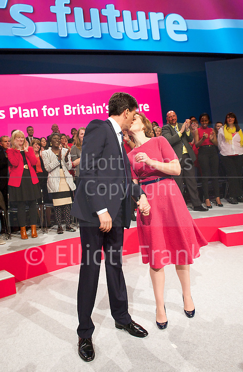 Labour Party Conference <br /> at Manchester Central, Manchester, Great Britain <br /> 23rd September 2014 <br /> <br /> Ed Miliband delivers his leaders' speech <br /> <br /> and walking off with his wife Justine Thornton <br /> <br /> Photograph by Elliott Franks <br /> Image licensed to Elliott Franks Photography Services