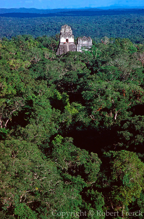 GUATEMALA, MAYAN CULTURE, PETEN TIKAL; classic and late classic, 300-900AD; Temples #1 and #2 rising above the surrounding rainforest jungle