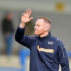 TELFORD COPYRIGHT MIKE SHERIDAN Telford boss Gavin Cowan waves to the crowd during the National League North fixture between AFC Telford United and York City at the New Bucks Head on Saturday, October 12, 2019.<br /> <br /> Picture credit: Mike Sheridan<br /> <br /> MS201920-025