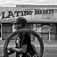 A man carries a tire past a market in Mendota in Fresno County in California's Central Valley, CA, Friday, Oct. 14, 2016. One of the worst droughts in California history officially ended this spring in all of the state's counties except Fresno, Kings, Tulare and Tuolumne. <br />