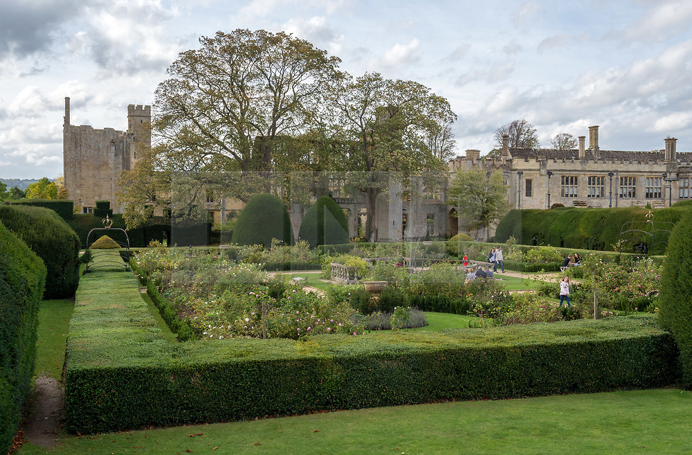© Licensed to London News Pictures. 13/10/2018. Winchcombe, Gloucestershire, UK. Views of Sudeley Castle and gardens. Archaeologists from DigVentures hope to unearth a long-lost Tudor garden at Sudeley Castle this weekend. Best-selling historical novelist Dr Philippa Gregory will also be joining the team. Philippa, who's well-known works include The Other Boleyn Girl and The White Queen, started her research into Sudeley Castle whilst working on a novel about Katherine Parr. For nearly 1,000 years, Sudeley Castle has hosted some of England's most famous monarchs including Henry VIII. It is also where Katherine Parr, Henry's last wife, later lived and was finally laid to rest. A recent geophysical survey at Sudeley revealed the ghostly outline of a long-lost Tudor garden, with traces of what could have been a banqueting house in the same area where pieces of Tudor masonry were found in the 19th century. Now experts say it is time to investigate further. The dig will take place at this Saturday and Sunday, October 13 and 14, and is thought to be the most significant archaeological investigation since the discovery of Roman villas on the estate in Victorian times. A specialist team from social archaeology company, DigVentures, will begin an investigation of the site, which aims to 'ground-truth' the geophysics results. They hope to reveal some of the Tudor secrets that remain hidden underground at the castle. Following the popular landscaping movement inspired by Capability Brown, many Tudor gardens were lost, and this is perhaps just one of only two in England where the original paths remain visible. Photo credit: Simon Chapman/LNP