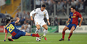Cristiano Ronaldo between Sergio Busquets and Xavi during the final of the UEFA football Champions League on May 27, 2009 at the Olympic Stadium in Rome.