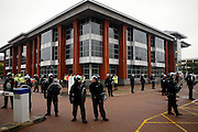 A large number of British policemen are standing in front of the British Airport Association (BAA) headquarters, to prevent climate change protesters to act near the building,  on Sunday, Aug. 19, 2007, Heathrow, England. More than 1800 police officers were deployed to counter the activists in their plan to disrupt the BAA activities on the site. Aviation is the fastest growing source of greenhouse gas emissions in the UK, and all our efforts to tackle climate change in other sectors are undone by the massive growth in air travel. Holding the camp at Heathrow aims to highlight the paradoxical government's airport expansion plans, target industry giants profiteering from the climate crisis, and raise awareness about the need to fly less. The camp also support local residents in their long-term struggle against the building of a third runway and the destruction of their communities. Heathrow, the world's busiest international airport, has been the target of Climat Camp campaing in 2007. www.climatecamp.org.uk   **Italy Out** .