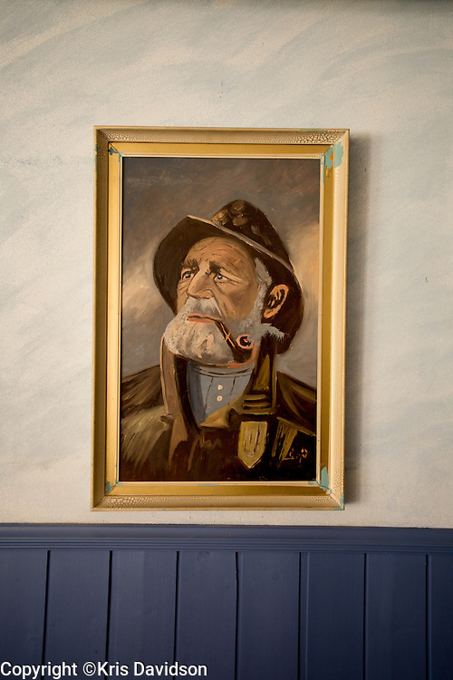 Painting of a pensive sailor in a diner in Smögen. Smögen is well known today for its long, wooden pier (around 600 meters), filled with shops in old fishing huts, which are frequented by a multitude of tourists during the summer. Smögen is one of the most popular tourist destinations on the Swedish West Coast, well known for its fish, prawns and other seafood, and one of Sweden's few fish markets is located here.