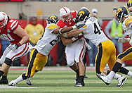 November 25, 2011: Nebraska Cornhuskers running back Rex Burkhead (22) is hit by Iowa Hawkeyes defensive back Shaun Prater (28) and Iowa Hawkeyes linebacker James Morris (44) on a run during the second half of the NCAA football game between the Iowa Hawkeyes and the Nebraska Cornhuskers at Memorial Stadium in Lincoln, Nebraska on Friday, November 25, 2011. Nebraska defeated Iowa 20-7.