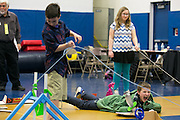"""Jacob Mellott, right, and Joey Beaman, both of Spencerport, participate in the """"Something Fishy"""" challenge at the Odyssey of the Mind Region 14 tournament at Spencerport High School on Saturday, March 12, 2016."""