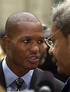 Boxer Bernard Hopkins (L), and boxing promoter Don King (R), speak outside City Hall, Wednesday, October 9, 2002, in Philadelphia. (Photo by William Thomas Cain/photodx.com)