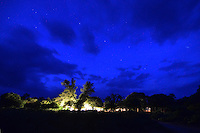 Night sky and lighted camp in Isosog