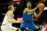 Feb. 13, 2011; Cleveland, OH, USA; Washington Wizards shooting guard Nick Young (1) looks for a pass around Cleveland Cavaliers shooting guard Anthony Parker (18) during the third quarter at Quicken Loans Arena. The Wizards beat the Cavaliers 115-100 for their first win on the road this season. Mandatory Credit: Jason Miller-US PRESSWIRE