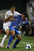 08 July 2009: Mariano Acevedo (HON) (11) and Charlie Davies (USA) (behind). The United States Men's National Team defeated the Honduras Men's National Team 2-0 at RFK Stadium in a 2009 CONCACAF Gold Cup first round game.